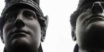 Two photographs of the face of Minerva, from the Green-Wood Cemetery in Brooklyn.